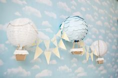 Decorate Chinese lanterns with circle cut outs and add basket for hot air balloon... leave red ones add flags and basket! ***