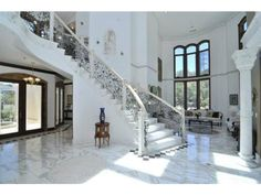 White marble floors and beautiful staircase