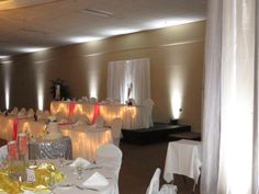 A look (from a distance) of Katie and Nick's 2 tiered head table, accented with uplighting in white, at their reception on June 14, 2014 at Chautauqua Suites in Mayville, NY
