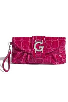 """Mix up the ways you carry your G-Style. Rock the wrist strap for a low-key evening and step it up by wearing it as a clutch for a nighttime of high style.     • Patent exterior. Silver-tone hardware.   • Front """"G"""" logo plaque. Croc-embossed textured design. Front flap with snap button closure."""