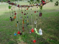 gypsy chimes in the yard  ~ a mixture of chains,   wire,   rich fall colored glass beads,  old keys,   bells   and little bit of velvet ribbon~