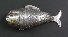 A HM silver pill box / snuff formed as an articulated fish with head hinging open with import marks Birmingham 1900. #silver #fish