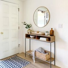 Made from richly-grained solid mango wood and supported by sturdy steel legs, our Industrial Storage Skinny Console's narrow size makes it easy to slip in the entryway or behind the couch. Skinny Console Table, Small Console Tables, Entryway Console Table, Narrow Entryway Table, Small Entryways, Hallway Decorating, Porch Decorating, Home Decor Store, Home Decor Inspiration