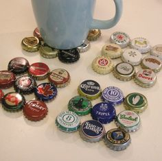 bottle cap coasters... better put some cork under it so you don't scratch the table. i should make this for my uncles man cave he collects them but just puts them in a bin