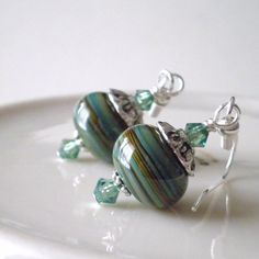 Lampwork Earrings Glass Bead Jewelry Green and Brown Swirl Swarovski Crystals Antiqued Silver Beaded Dangles Handmade Jewelry. $18.00, via Etsy.