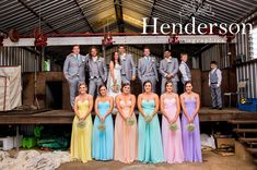 Groomsmen wearing grey suits, bridesmaid in colourful pastel dress in Australian shearing shed. https://www.facebook.com/HendersonPhotographics