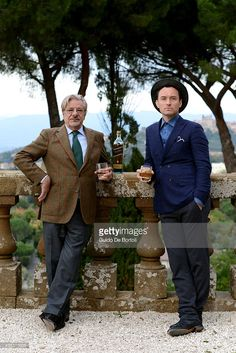 Jude Law and Giancarlo Giannini toast at the photocall of Johnnie Walker Blue Label's The Gentleman's Wager II at Villa Mondragone on October 31, 2015 in Rome, Italy.