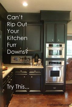 A great solution for ugly soffits you can't take down...add bead board and moulding and paint the same color as the cabinets! Looks like a million bucks!