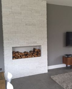 White stone veneers used to create a faux chimney breast
