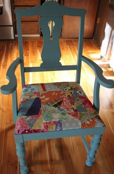 My Grandpa's old chair with a new coat of chalk paint and patchwork seat cover.