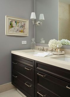 Ritz-Carlton Showcase Apartment by Samantha Todhunter - Traditional Home  wall paint Benjamin Moore 2112-50 Stormy Monday, countertop calcutta gold marble with leather finish