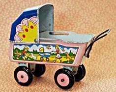 Vintage tin litho toy baby carriage / pram.