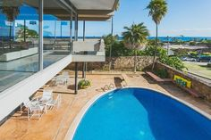 Have a nomination for a jaw-dropping listing that would make a mighty fine House of the Day? Get thee to the tipline and send us your suggestions. We'd love to see what you've got. Cancun Hotels, Beach Hotels, Beach Resorts, Oval Pool, Mid Century Exterior, Modern Homes For Sale, Hawaii Homes, Modern Pools, Vintage Hawaii