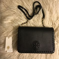 """NEED GONE! Tory Burch Marion combo Crossbody Tory Burch Marion Combo Crossbody in black!  * Holds a small wallet, a phone, lipstick and a makeup compact * Flap with magnetic snap closure * Adjustable, removable cross-body strap with 23"""" (58.5 cm) drop * 1 exterior zipper pocket under flap * 1 interior zipper pocket,2open pockets * Height: 5.98"""" (15 cm) * Length: 8.61"""" (21.6 cm) * Depth: 2.51"""" (6.3 cm) 100% authentic & NWT ships in dust bag  Still on Tory Burch website for full price…"""