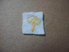 embroidery of thor's hammer on 1x1inch felt