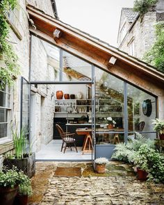 eighteenth-century weavers' cottage lovingly restored The courtyard entrance and kitchen, with its metal-framed windows, have an unexpected French feel.The courtyard entrance and kitchen, with its metal-framed windows, have an unexpected French feel. Future House, Design Exterior, Interior And Exterior, Kitchen Interior, Interior Architecture, Interior Garden, Design Kitchen, Natural Architecture, Interior Plants