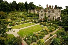 Gravetye Manor, an Elizabethan-era English country estate-cum-hotel and restaurant—once the home of prominent Irish-born gardener and writer William Robinson—surrounded by 30 acres of historic gardens. Photo courtesy of Gravetye Manor. English Country Gardens, English Countryside, Trianon Palace Versailles, Brighton, Gravetye Manor, Manor Garden, Garden Cottage, English Manor Houses, Country House Hotels