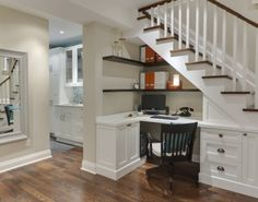 Construct a perfectly functional office under the basement stairs with built-in cabinetry and convenient open shelving to store bills and household paperwork. Save space and stay organized all under one staircase.