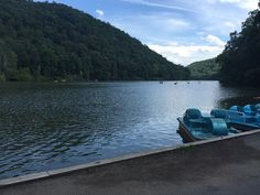 There is a lot to do on this mountain lake! Kayaks and Paddle boarders enjoy the water in the distance at Hungry Mother State Park, Virginia