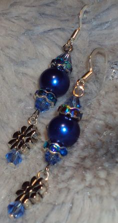 Daisy's in Blue!  Handcrafted Blue Glass Pearls with Rhinestone Crystal accented with Swarovski Crystal Silver Dangle Earrings by JewelryByTracyO on Etsy
