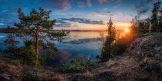 Panoramic sunset view to lake Vanajavesi, captured from the top of Vanajanniemi rocks Hämeenlinna, Finland.