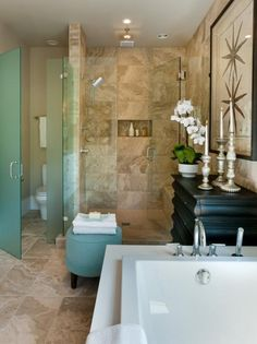 These tiles are beautiful. Also am a fan of the tub. #bathroom #remodels done right