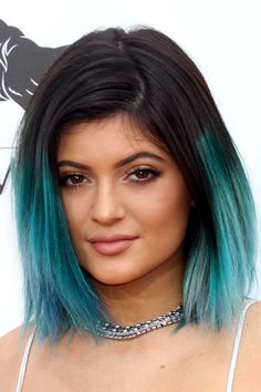 I am a little obsessed with candy colored hombre hair.  Although blue may be too intense and well I may be too old for this.