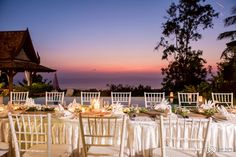 Sunsetting over your wedding reception dinner at a privaye villa in Koh Samui