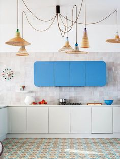 The lighting isn't to my taste, but I really like that upper cabinet. The rounded corners make it look deliberate, rather than like a few cabinets floating in space. I also really like that color of blue for a kitchen // NI6