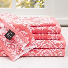 Add a pop of color to your bathroom with the fun Echo Design™ Surat 6 Piece Jacquard Towel Set. This 100% cotton set features a coral background with white decorative medallions. Each towel reverses to the opposite colors. Two bath towels, two hand towels and two washcloths are included in this set.