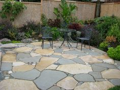 Interesting mix of patio slabs and small stones. Pretty colors for a very natural look.
