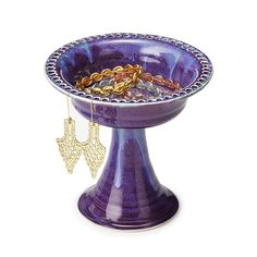 Beautifully handmade, this clay pedestal offers hand drilled holes to hang earrings and a dish to hold petite trinkets.