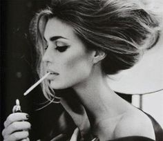 Hair and makeup. I love this but without the ciggy!