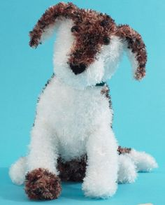 Free Knitting Pattern for Petey the Puppy - Dog softie approx 12 ins [30.5 cm] tall. Designed by Bernat