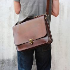 This full-size leather briefcase is the perfect compliment to the more artsy business professional. Large enough to carry your essentials without taking