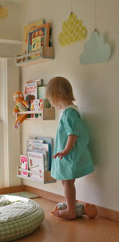 Hang the Ikea Bekvam spice rack to hold children books! They are low profile so they don't take up much room, either.