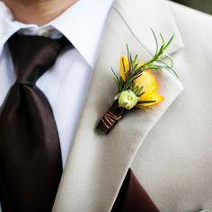 Brides.com: 33 Boutonnieres to Suit You Both A ribbon-tied boutonniere made of astilbe and greenery, created by Mallory Joyce.Photo: Jon Schaaf Photography