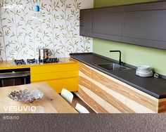Post-holiday cleaning up is easy when your surfaces are antibacterial! This bright and sunny kitchen uses Lapitec® Vesuvio in Ebano for its counters and cabinets.