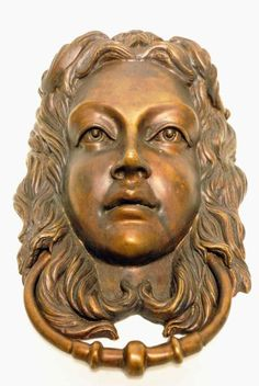 "Large and unusual door knocker. In the form of a young woman''s face with cascading hair; illegible foundry mark verso; approximately 11""H, 7""W, 3 1/4""D"