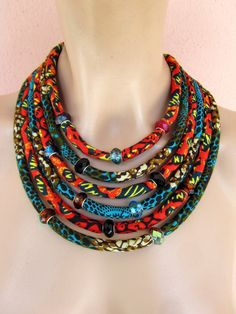 Multi Strand African necklace / fabric Statement necklace , African jewelry, Wax print fabric jewelry - pinned by pin4etsy.com