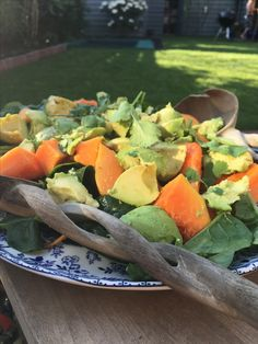 Summer on a plate: avocado, papaya, spinach and an orange juice based dressing