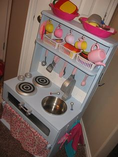 Play Kitchen - compact, but room for storage, burners, sink.  really like the color.  maybe with some green & orange accents to match the playroom.