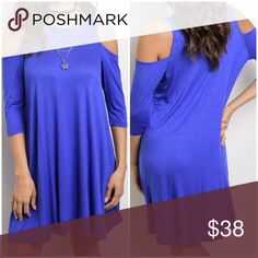 Peek-a-boo Shoulders Dress This flowy dress is so comfortable, you will never want to take it off! It features 3/4 sleeves and shoulder cut-outs. 60% polyester, 35% rayon, 5% spandex. Dresses