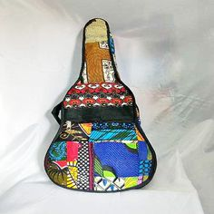 Violin cover made out of kitenge fabric.shoulder strap for carriage also side pocket