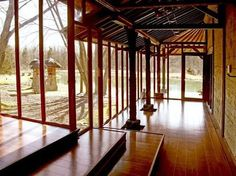This upstate New York home has authentic Balinese Pavilions with dark wood flooring, stone walls, light bamboo construction and exposed rafters.