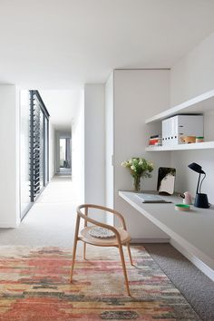 Interior Design Idea - 13 Examples Of Desks In Hallways // An all white work area in this long hallway makes for a bight spot to get to work, and the long shelves provide tons of extra storage space.