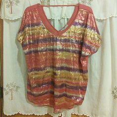 Brand new  coral, gold, and purple sequined shirt Brand new size 2 sequinned short sleeve shirt. It's very pretty with the coral, gold and purple. Maurices Tops Blouses