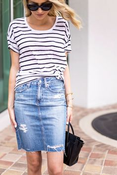 A Casual, Cool Way to Wear a Distressed Denim Skirt via @WhoWhatWear