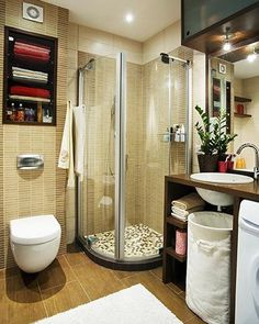 great use of a small space... wall hung toilet, small glass shower stall and built in shelves.