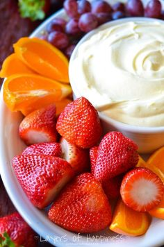 1 (32 ounce) container Low-Fat Vanilla Yogurt 1 (8 ounce) container Lite Cool Whip 1 (3.4 ounce) box dry instant vanilla pudding mix Fruit for serving